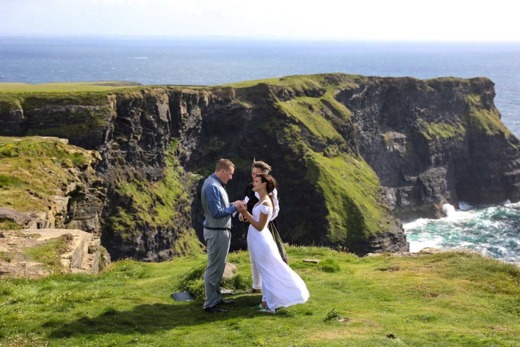 Couple being married at the Cliffs of Moher