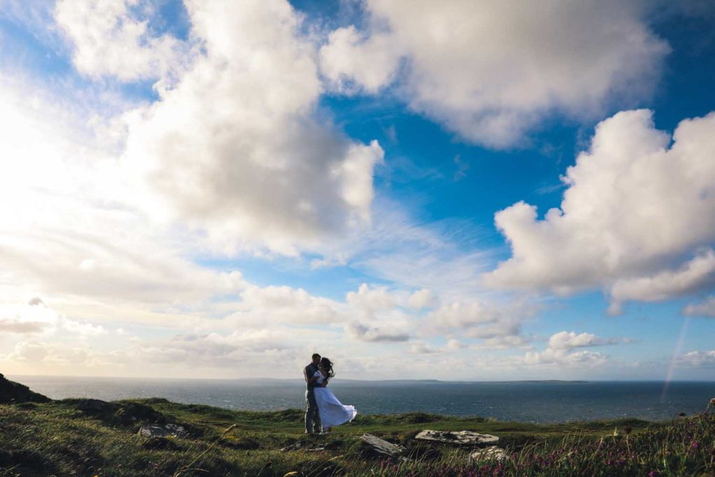 Couple kissing against a spectacular view of the Atlantic Ocean