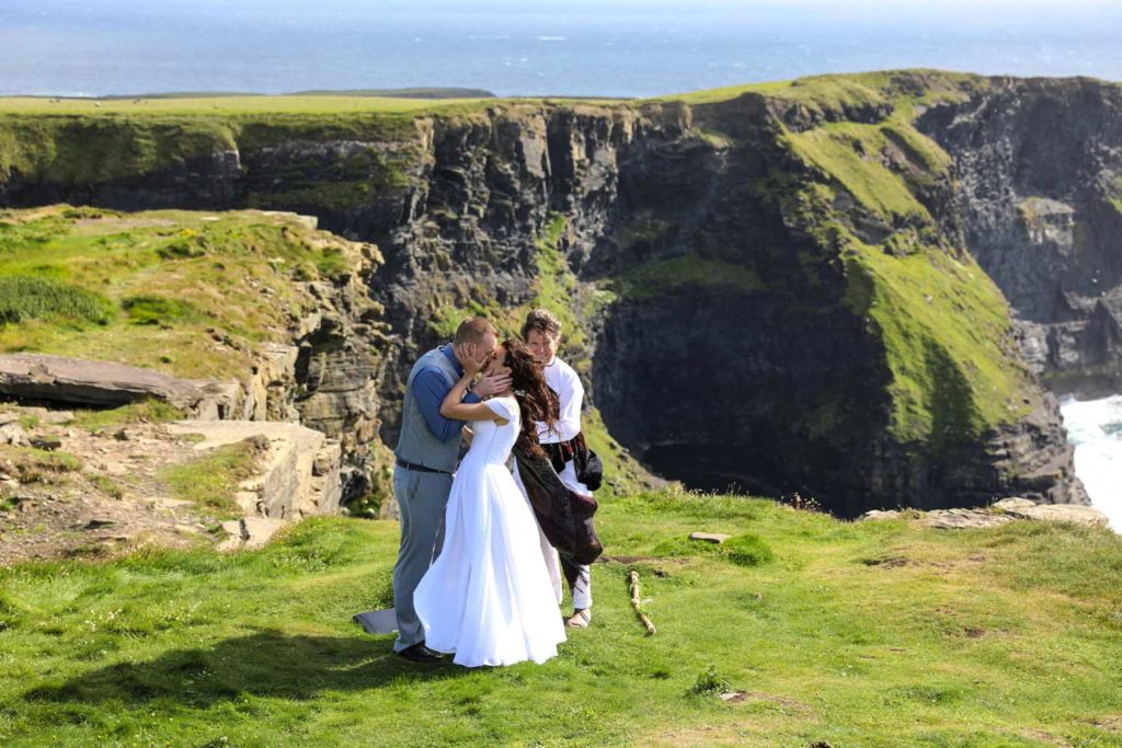 Sealing the deal on their wedding day at the Cliffs of Moher