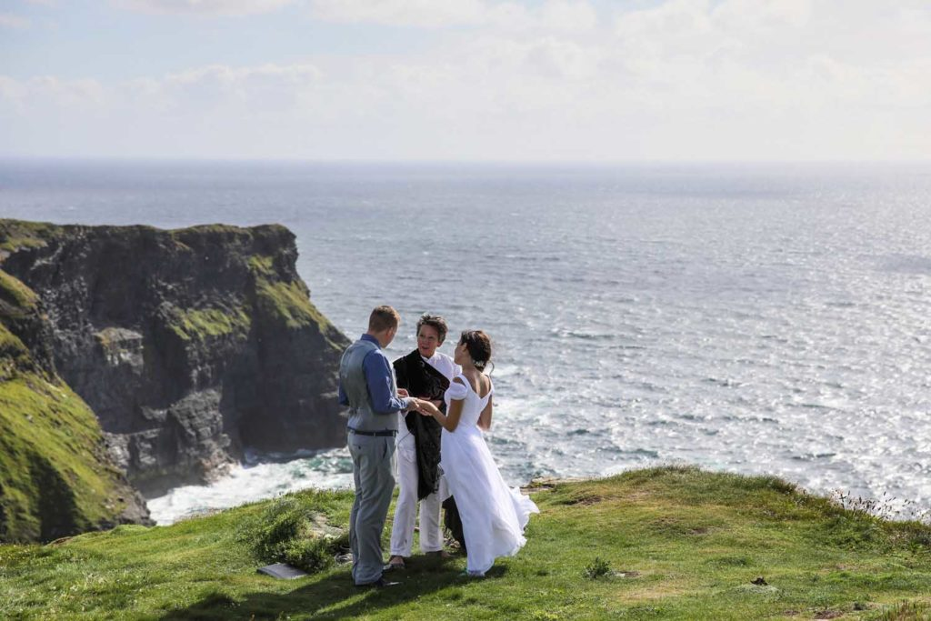 Couple getting married on the Cliffs of Moher, Ireland