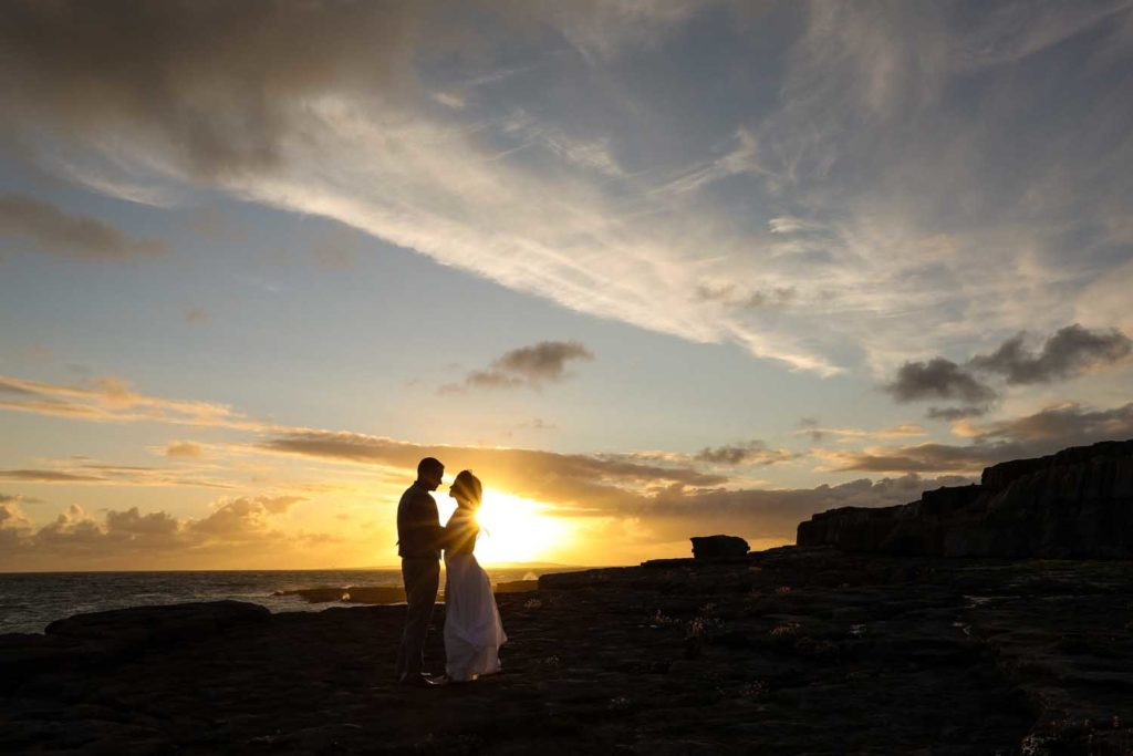 Close up of married couple at sunset on the irish coast