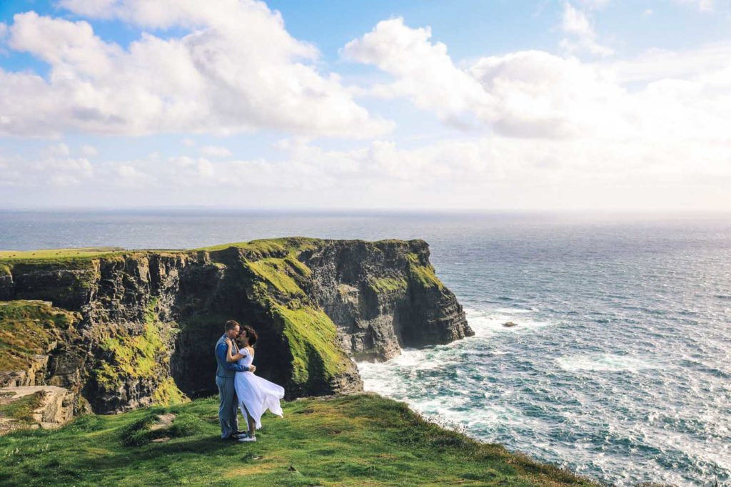 Couple kissing alone on the Cliffs of Moher