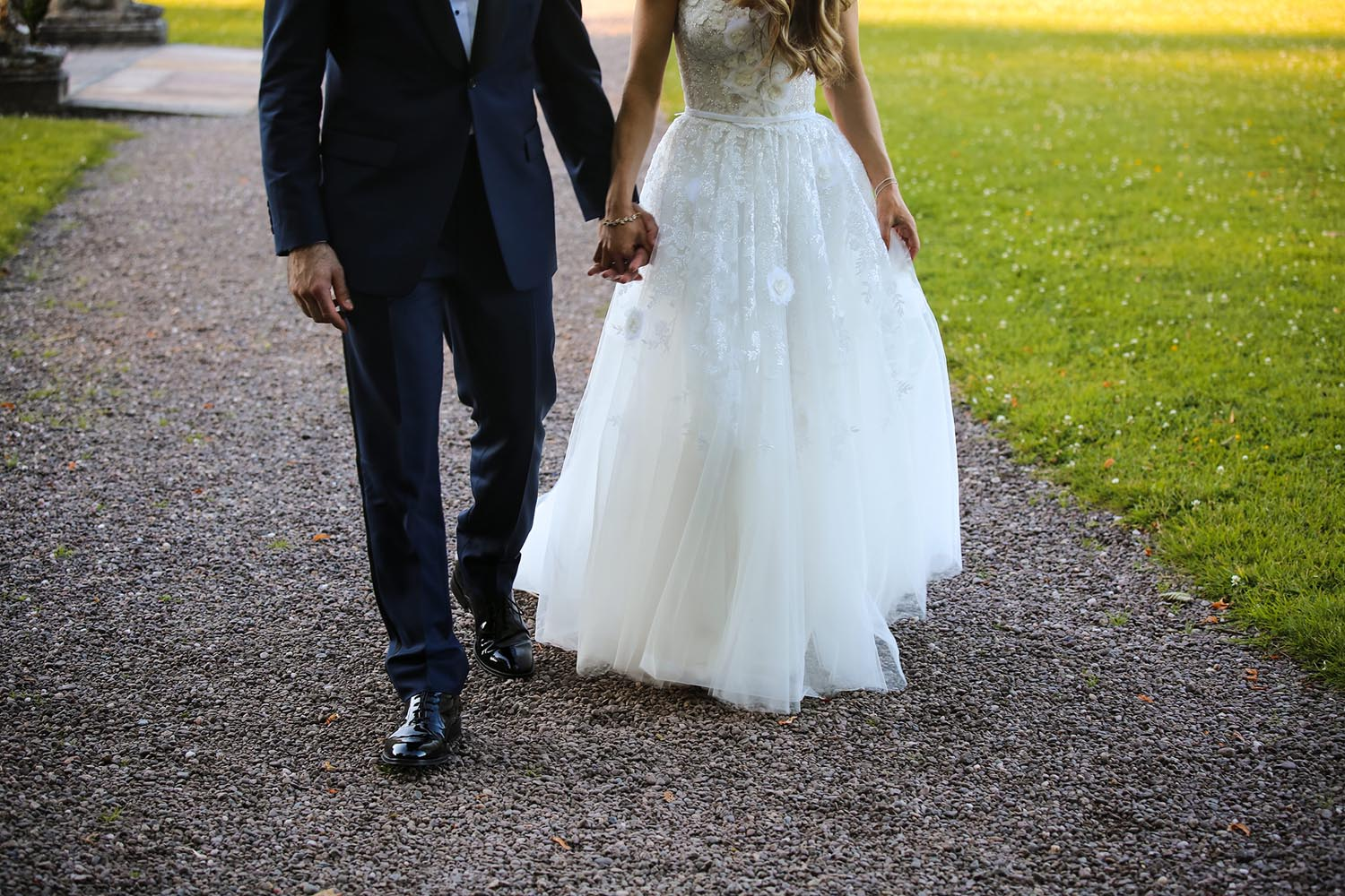 Photo of groom and bride walking