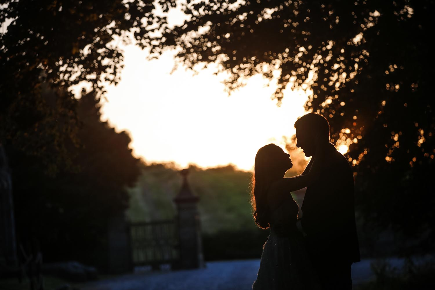 Silhouette of a newly married couple at sunset