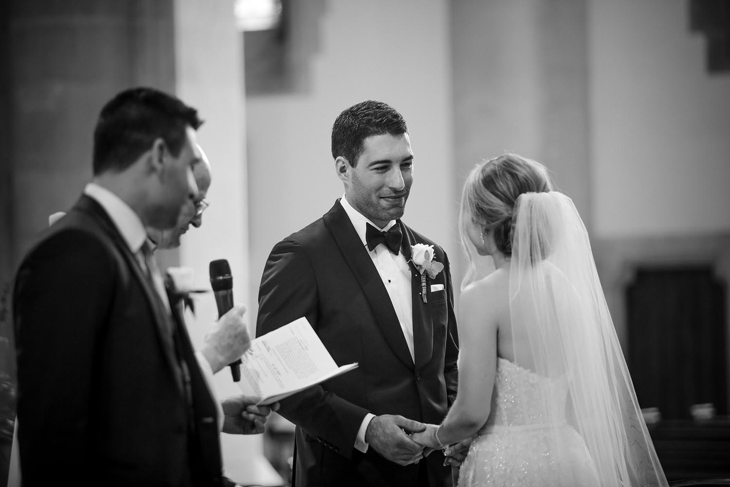 Bride and groom smiling at each other during their wedding ceremony