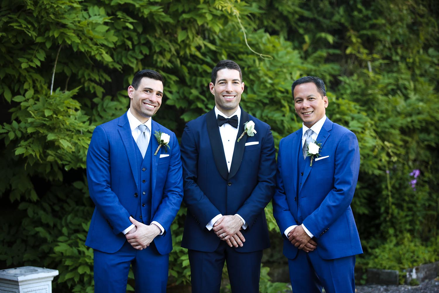 Groom posing with his groomsmen
