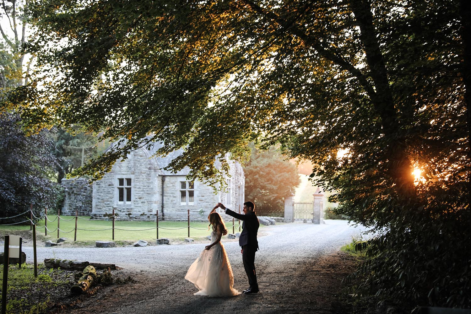 Newly married couple enjoying the sunset at Castle Leslie Estate