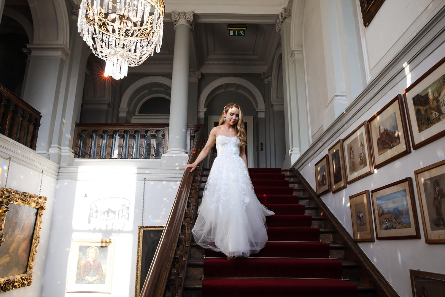 Bride descending the stairs of Castle Leslie