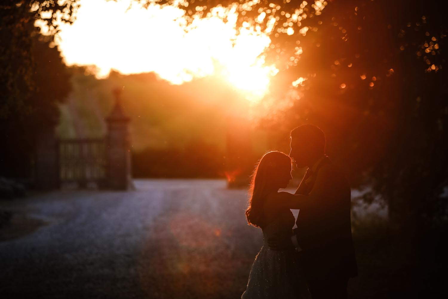 Married couple with sunset in the background