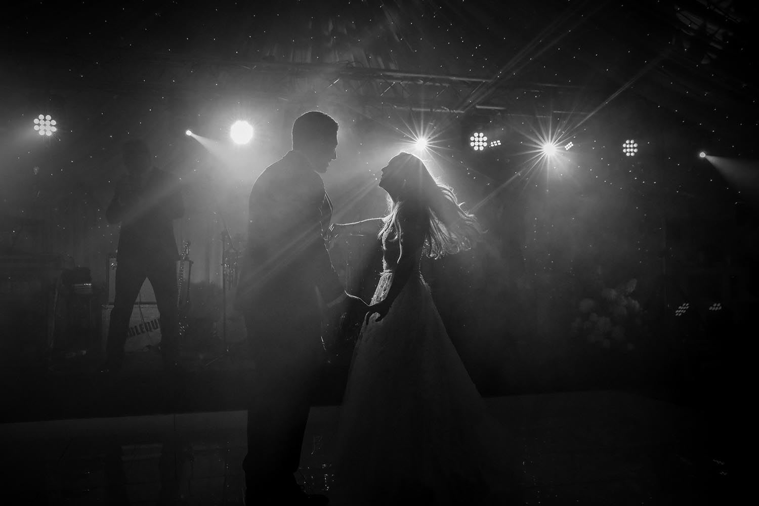 Couple dancing together on their wedding day