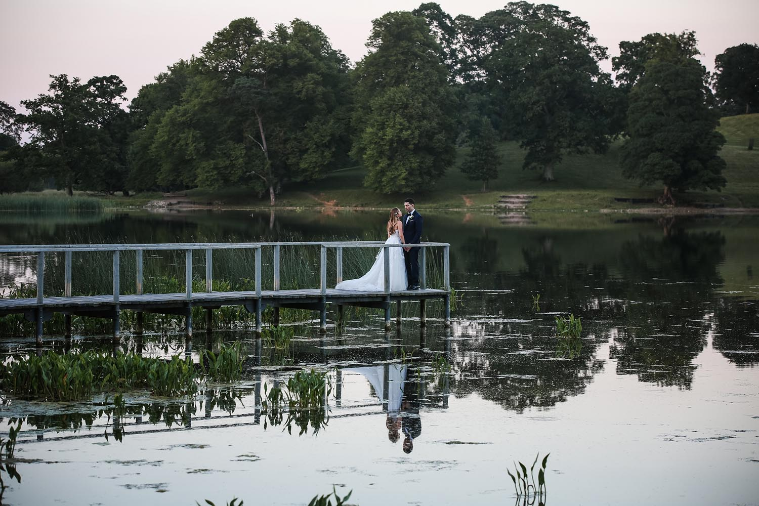 On the lake - photo of bride and groom at Castle Leslie