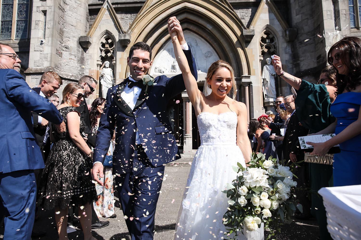 Throwing confetti on the newly married couple outside St Macartan's Cathedral
