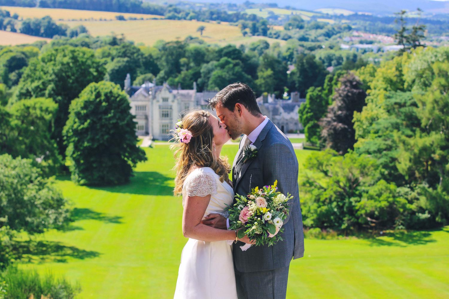 Bride and Groom kissing on their wedding day in Killruddery gardens