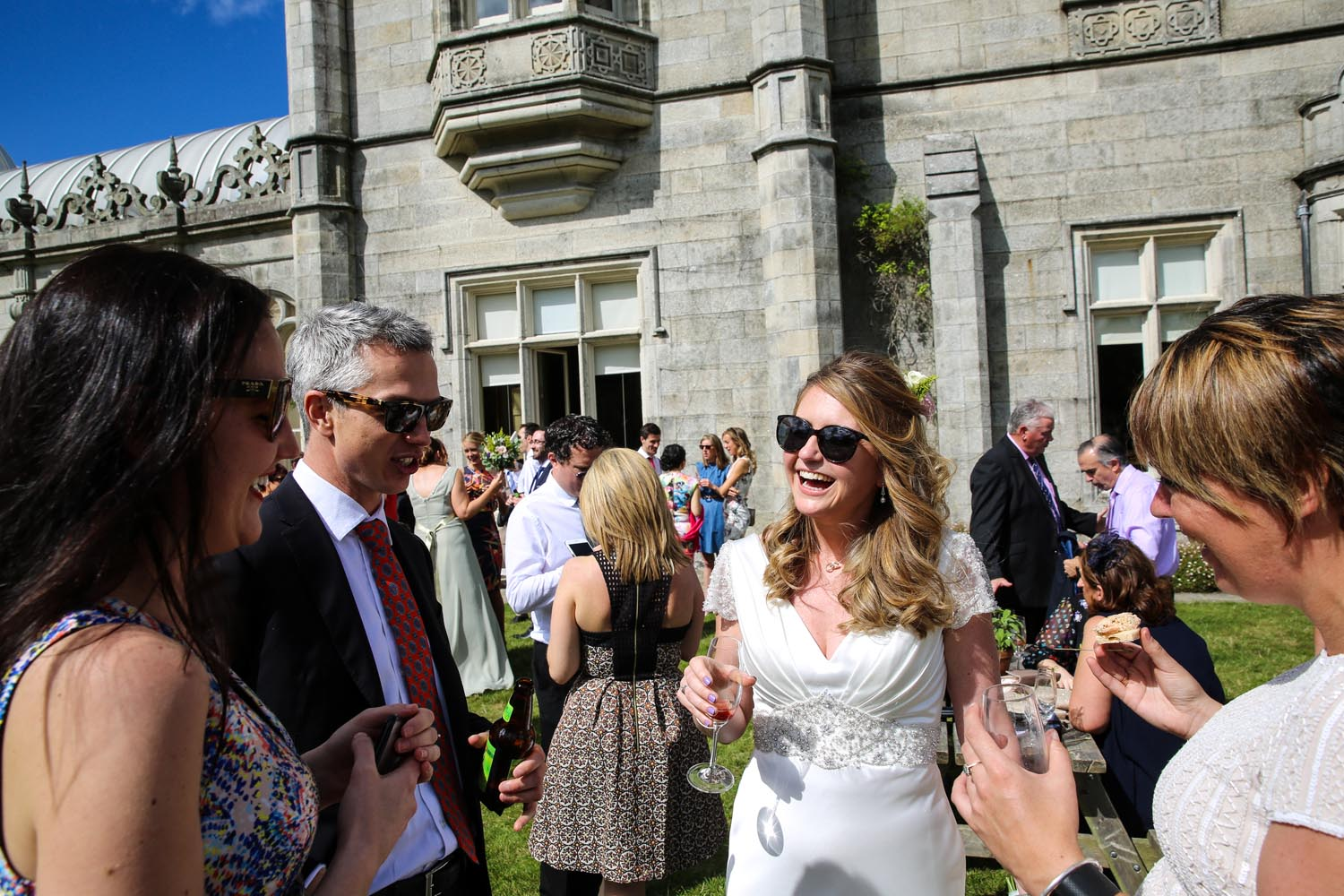 Bride enjoying champagne outside Killruddery House