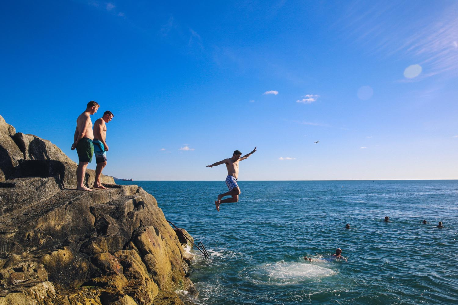 Jumping into the sea at the Forty Foot, Dublin