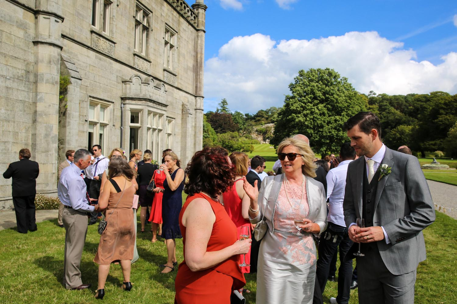 Guests enjoying sunshine at a Killruddery House wedding