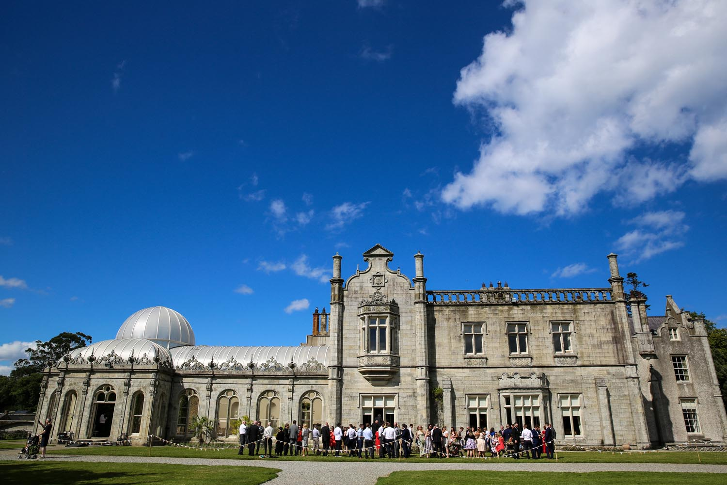 Wide angle view of wedding party enjoying a reception at Killruddery House
