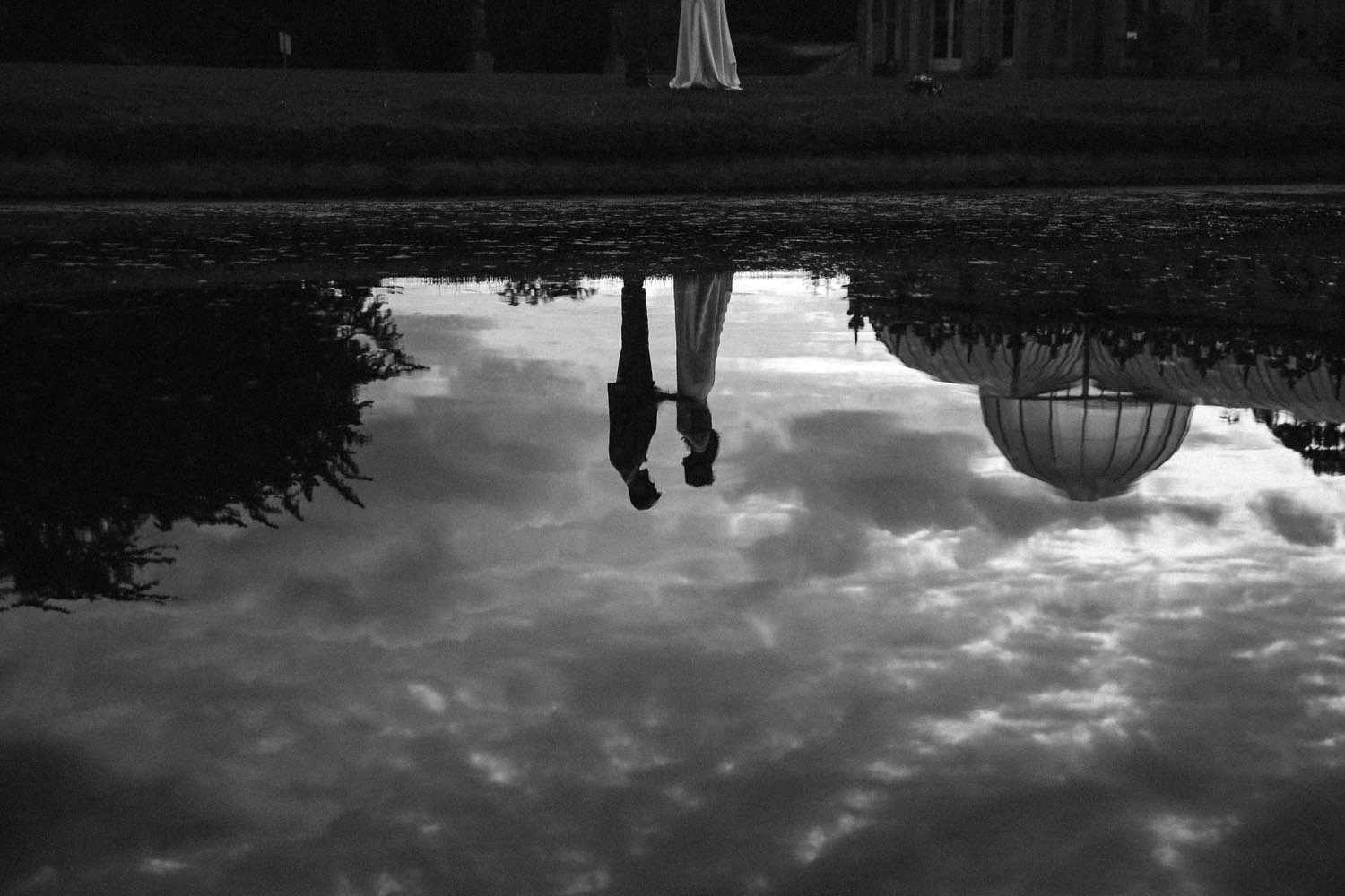 Reflection of a married couple in the lake at Killruddery