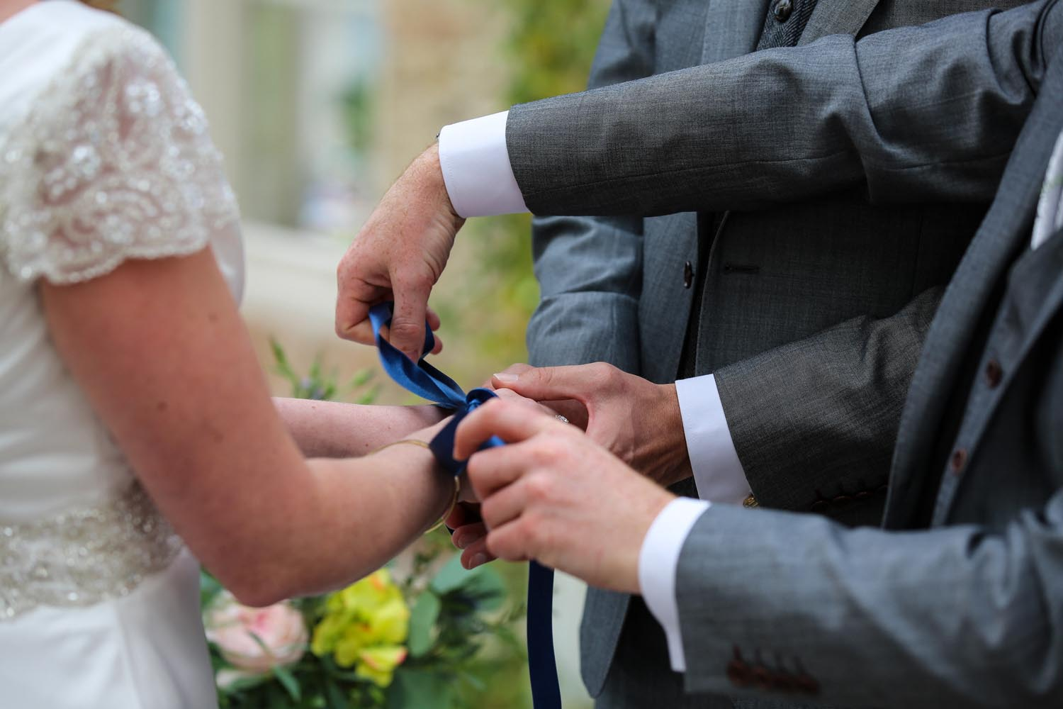 Tying a knot during their wedding ceremony