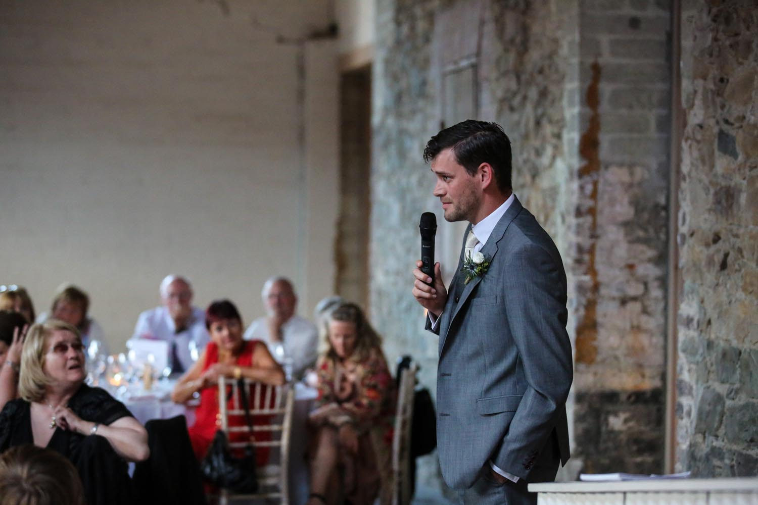 Groom making a speech on his wedding day