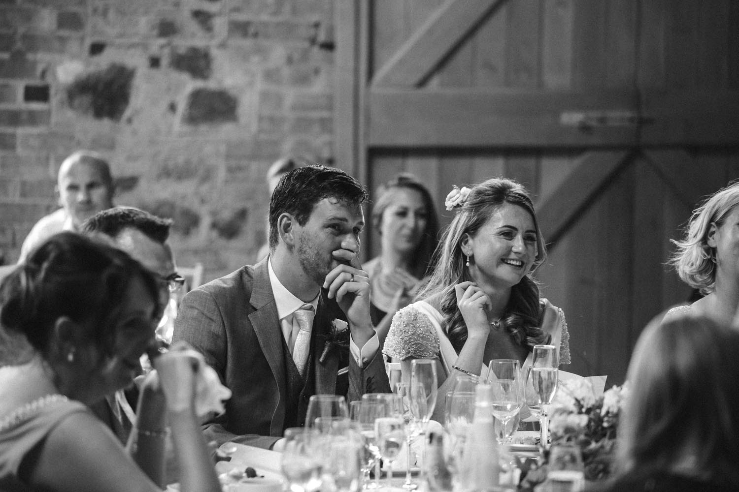 Couple photographed during wedding speeches