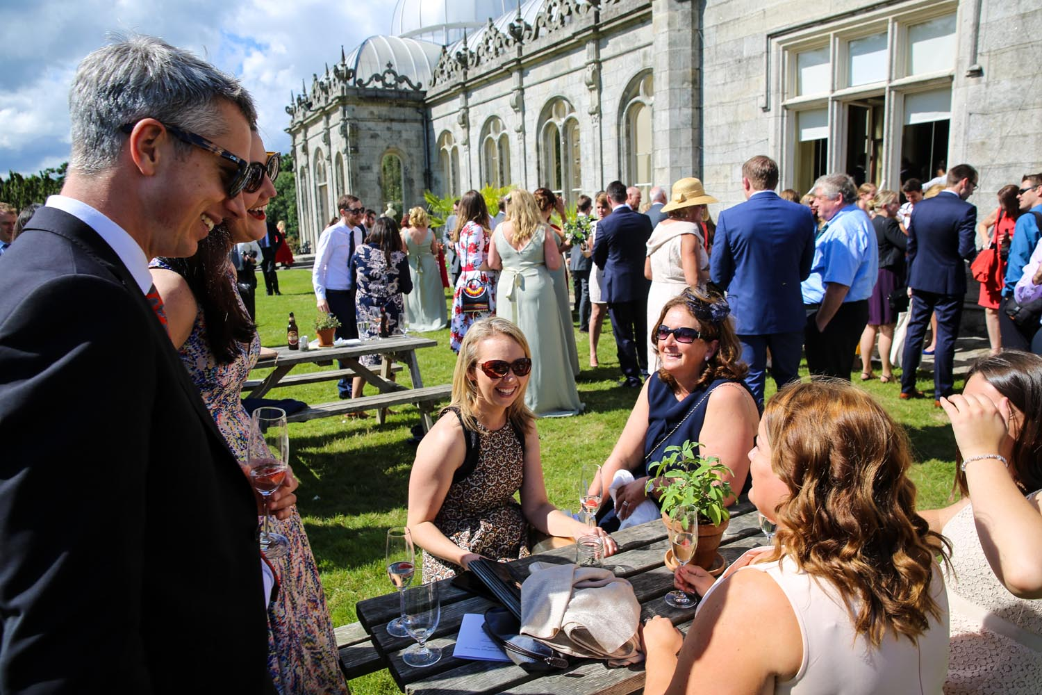 Guests at a wedding reception outside Killruddery House