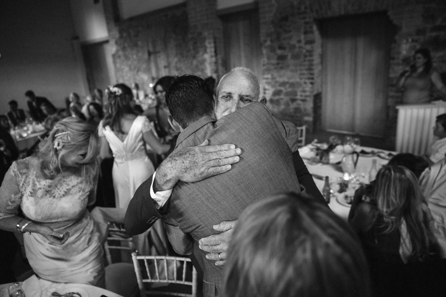 Guests embracing during a wedding celebration