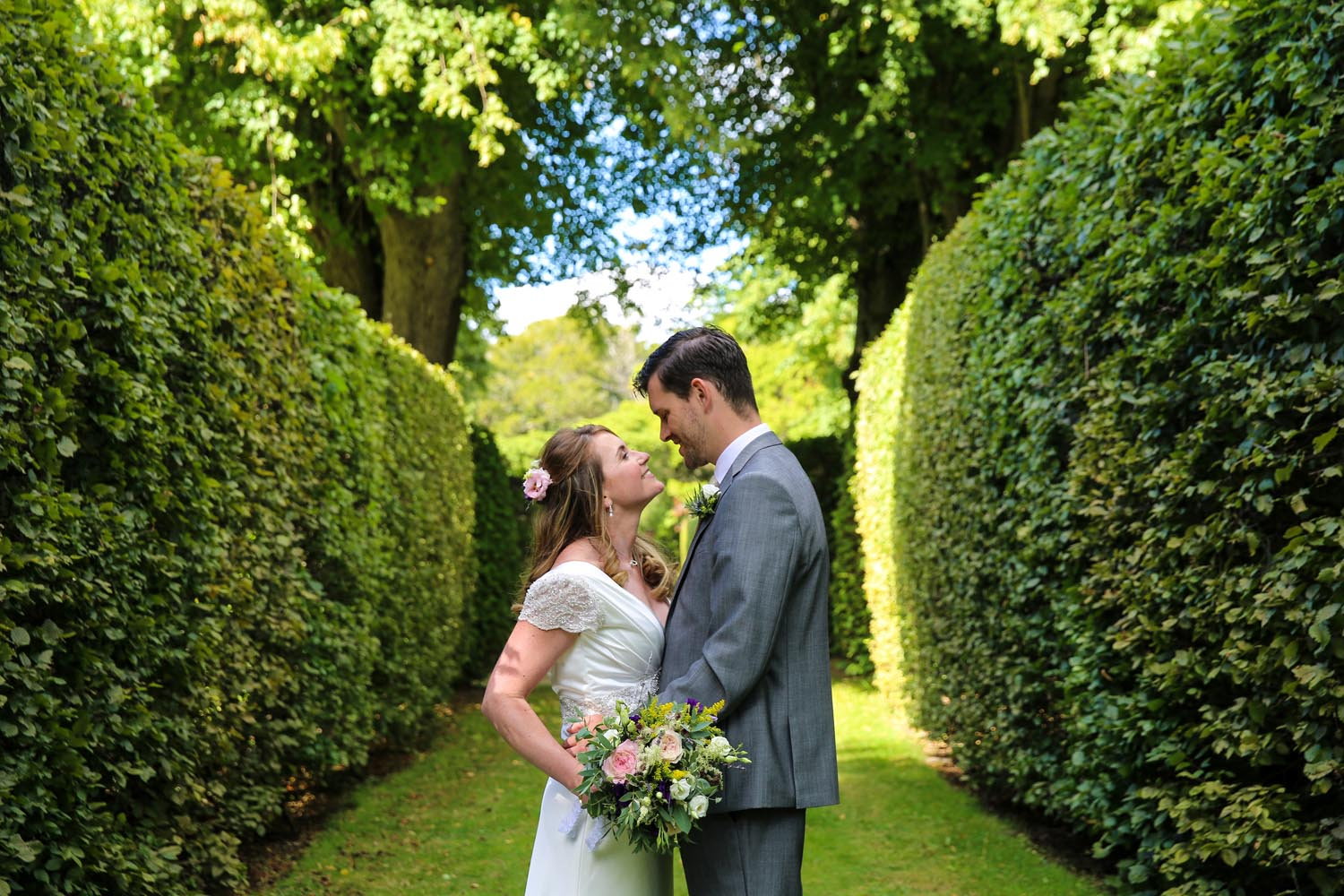 Couple on their own in the gardens of Killruddery House
