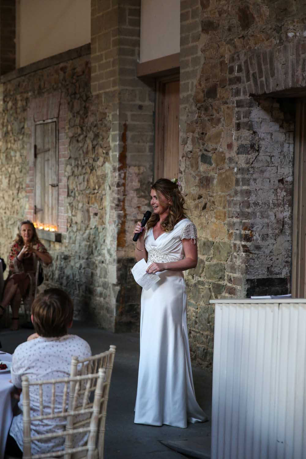 Bride speaking at her wedding
