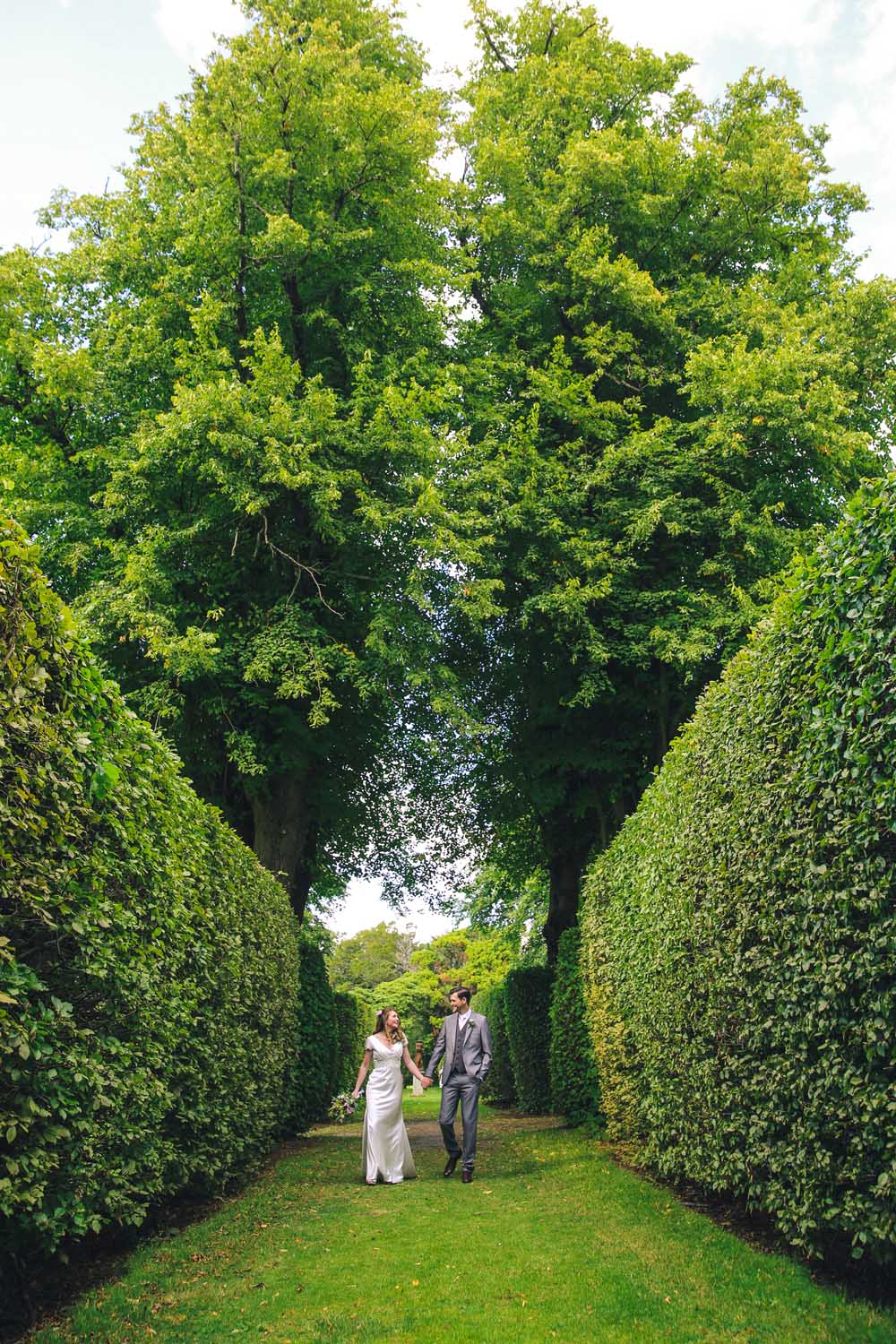 Bride and Groom strolling through Killruddery gardens