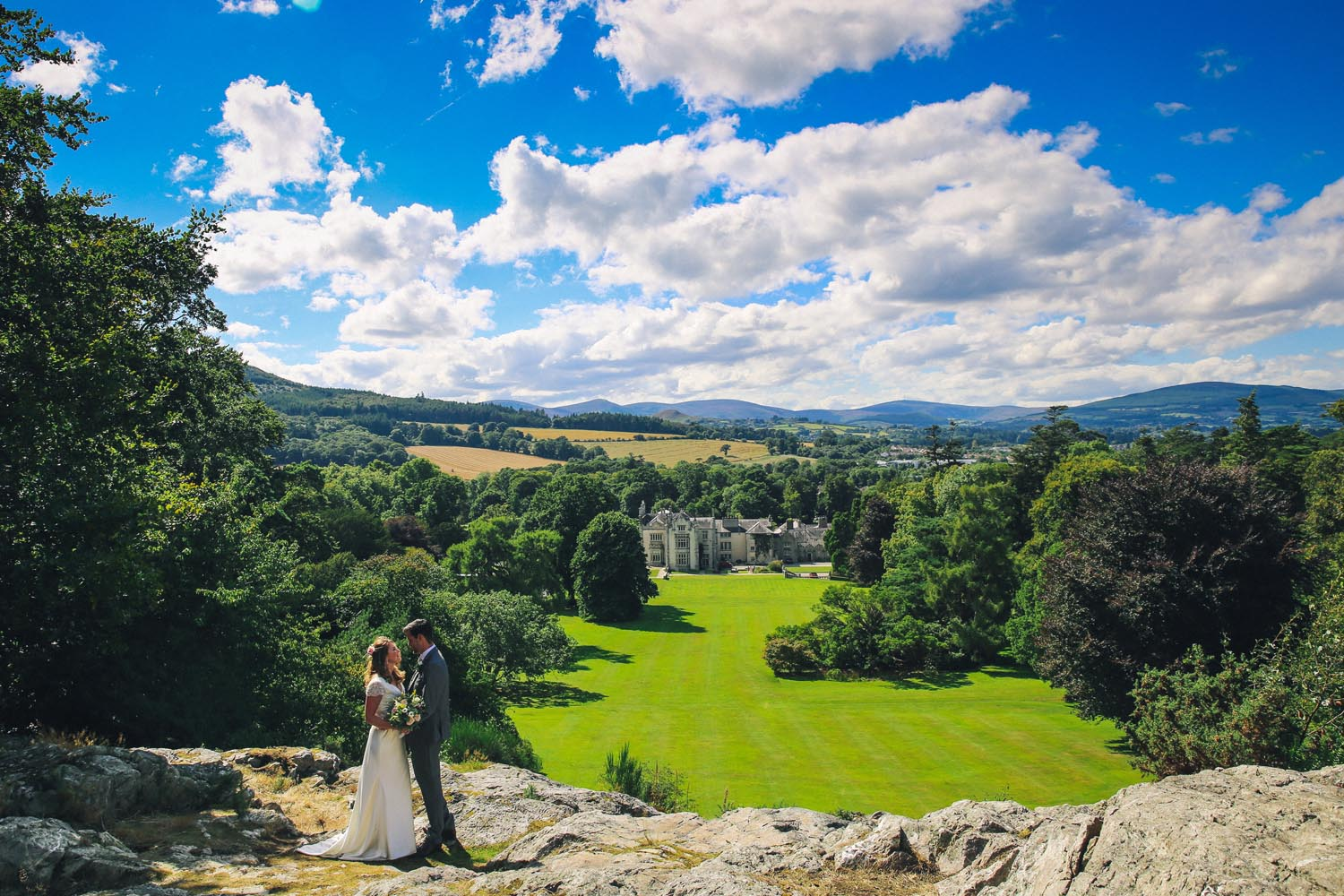 Newly married couple with Killruddery Estate in the background