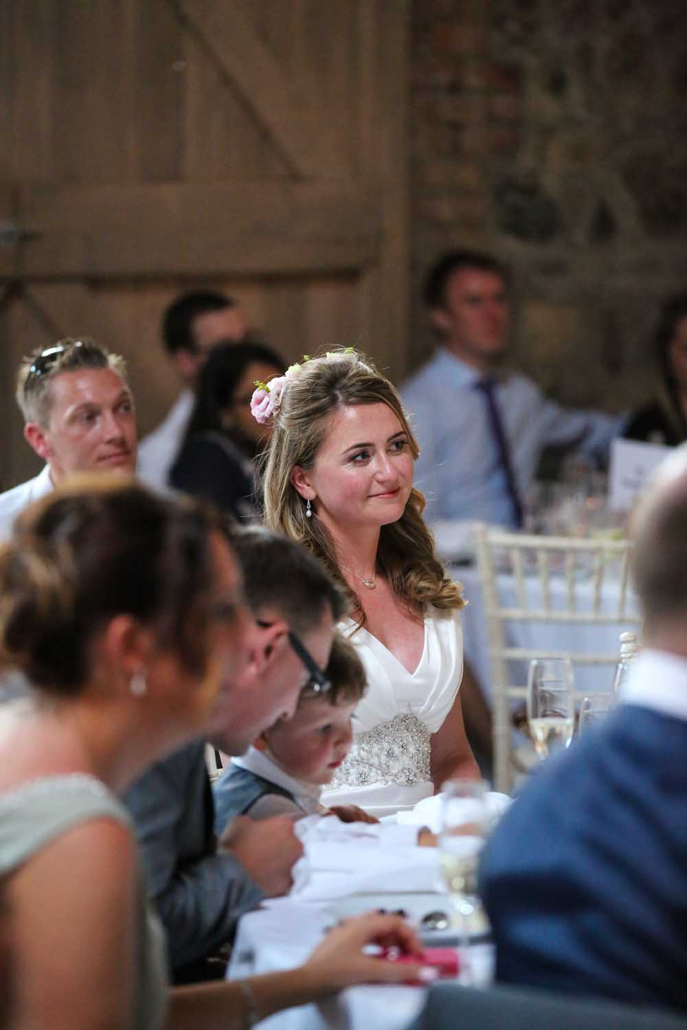 Bride listening to speeches on her wedding day