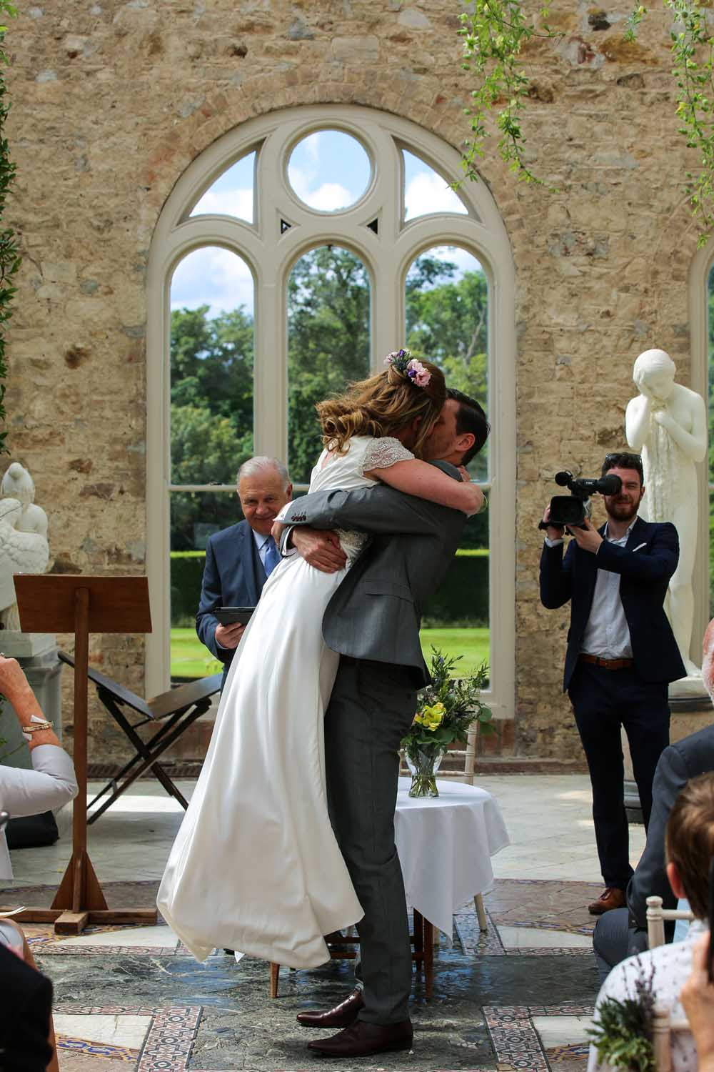 Couple embrace after being married in the Orangery