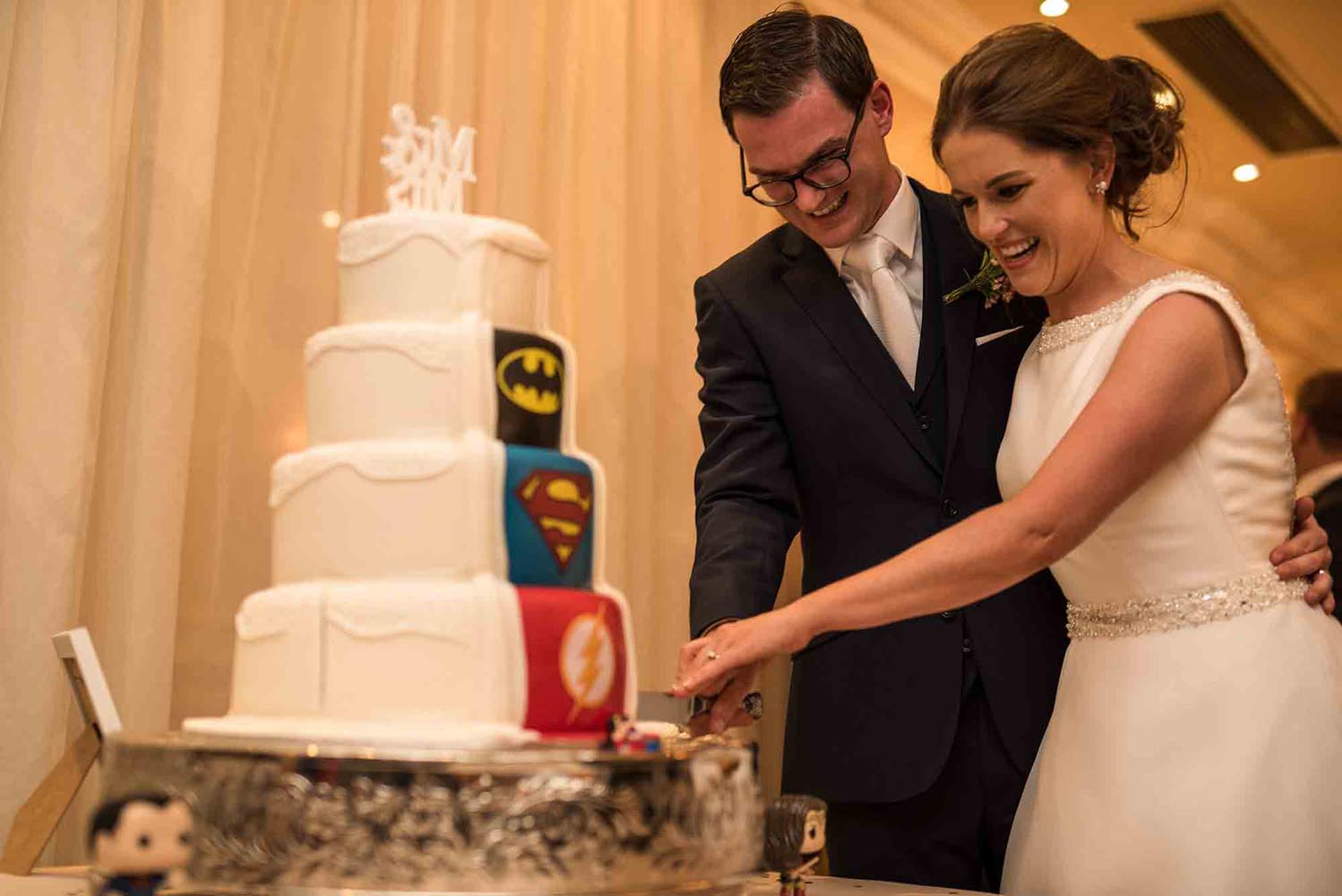 Close up of bride and groom cutting their wedding cake