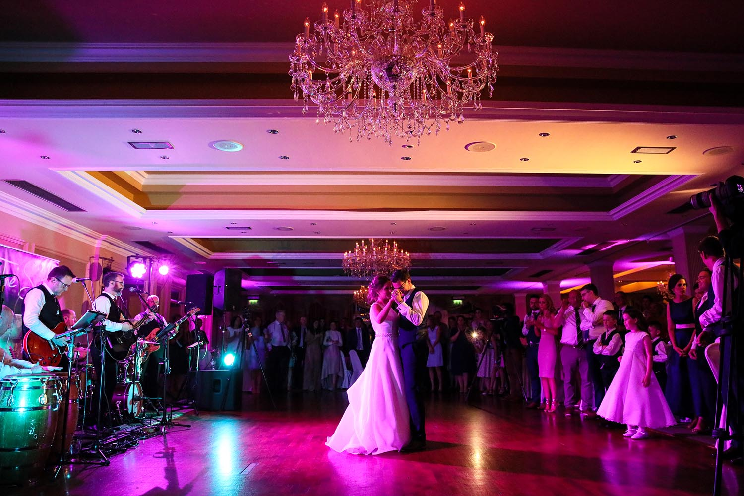 Couple dance as everyone looks on during a wedding
