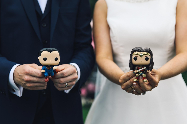 Married couple with superhero figures