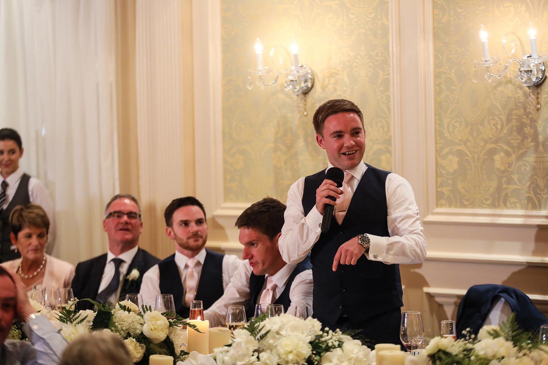 Bestman making a speech