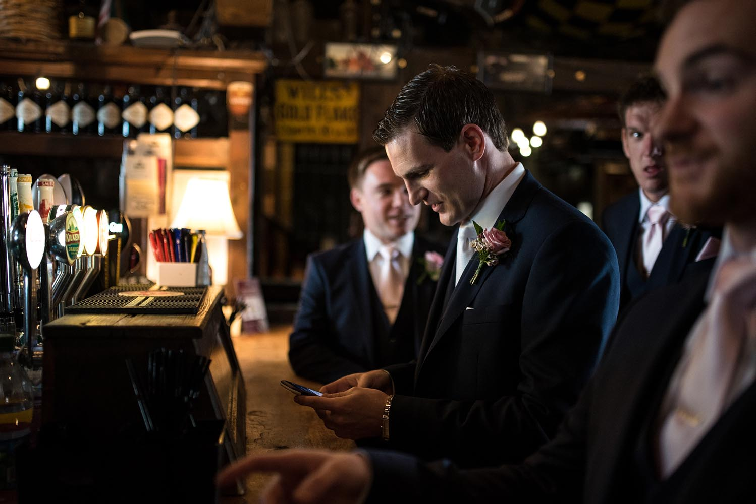 Groom checking his messages