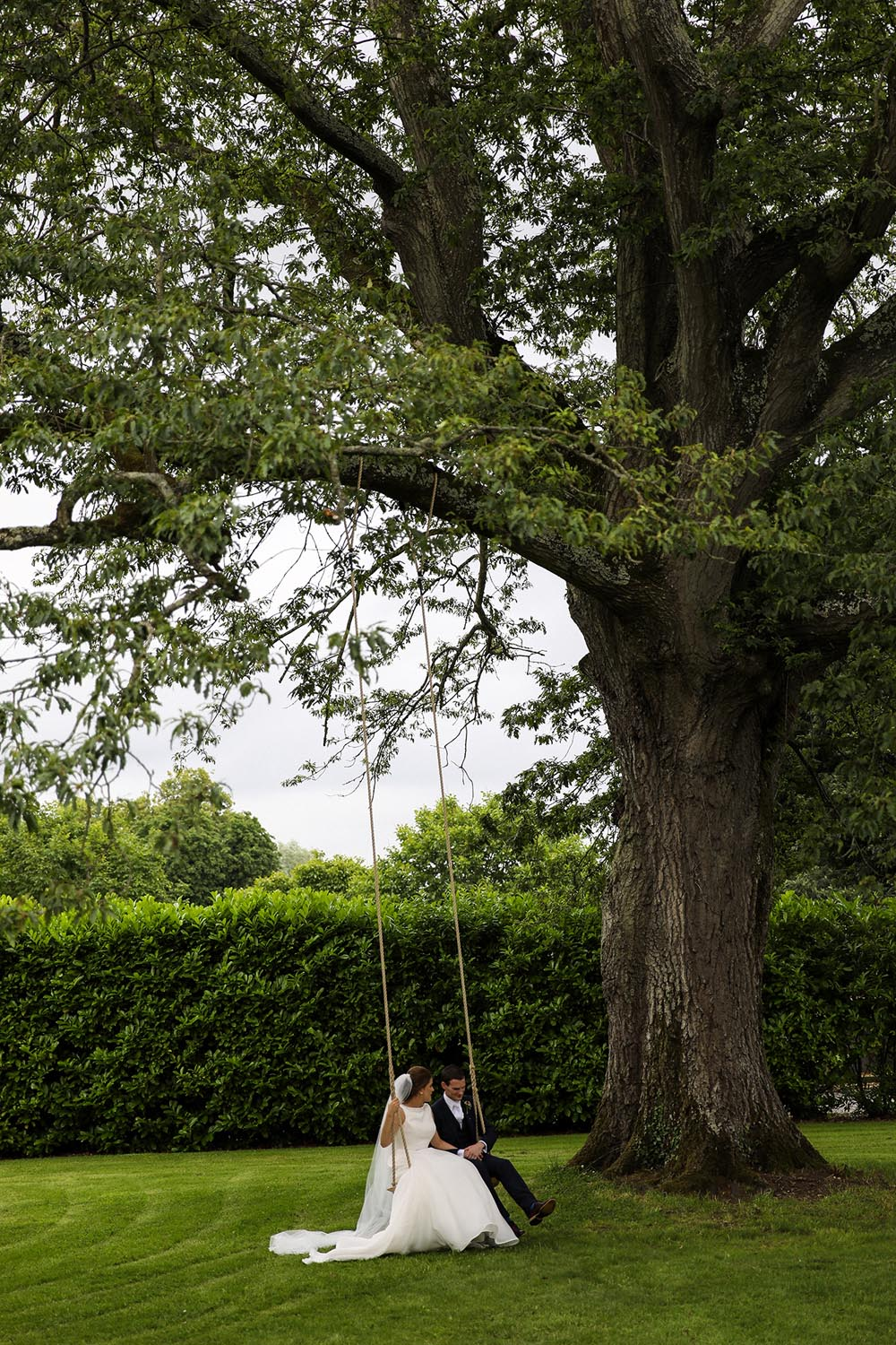 Newly married couple on a swing at the Newpark Hotel Kilkenny