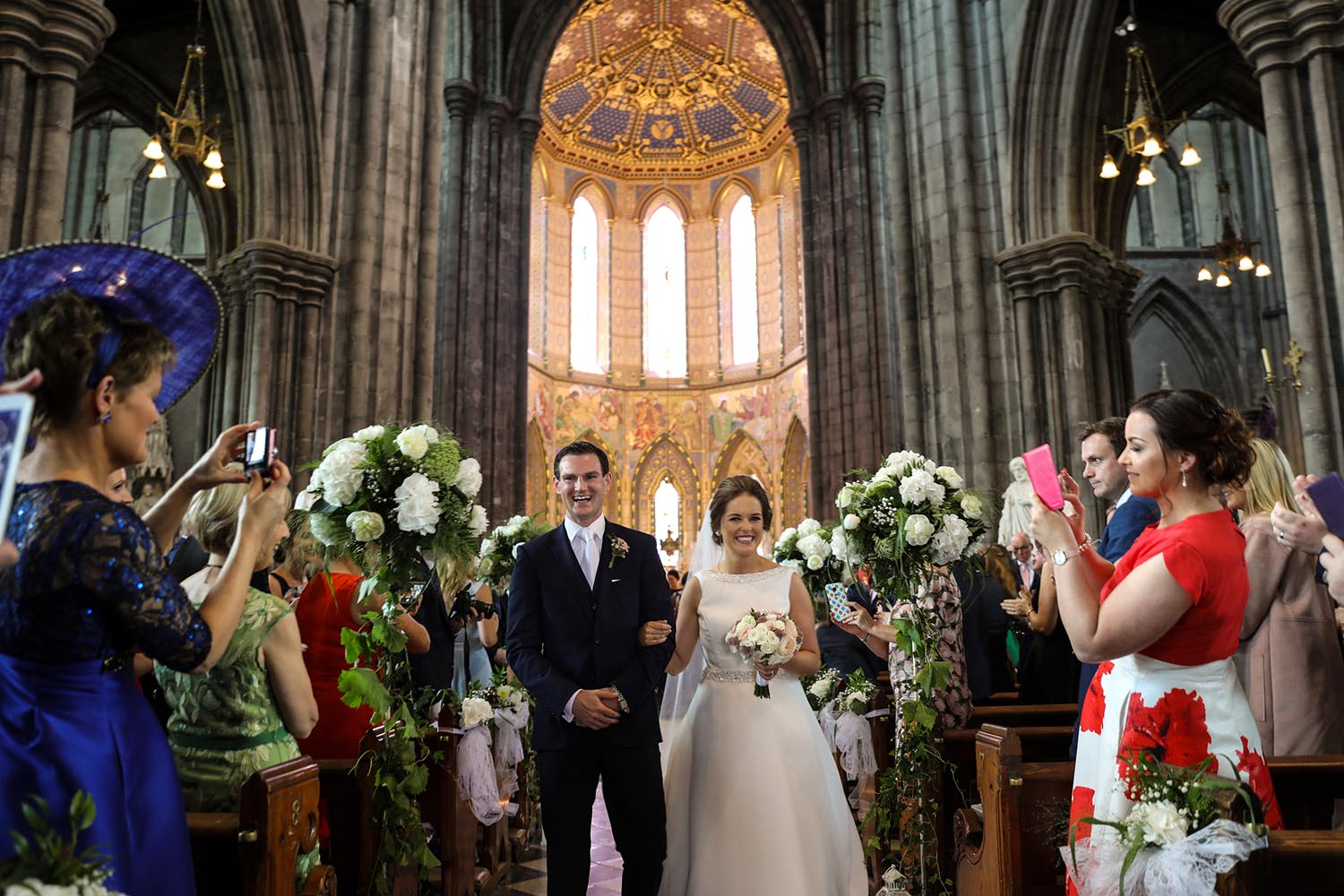 Married couple walk down the aisle at St Mary's Cathedral in Kilkenny