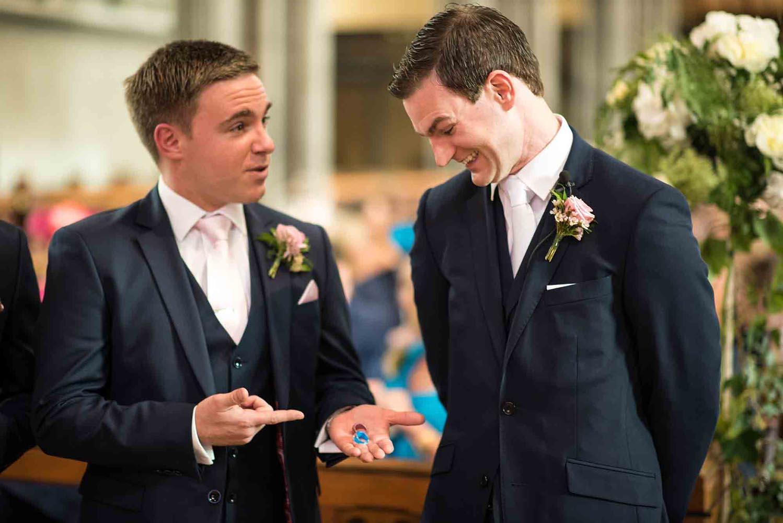 Groom looking at wedding rings