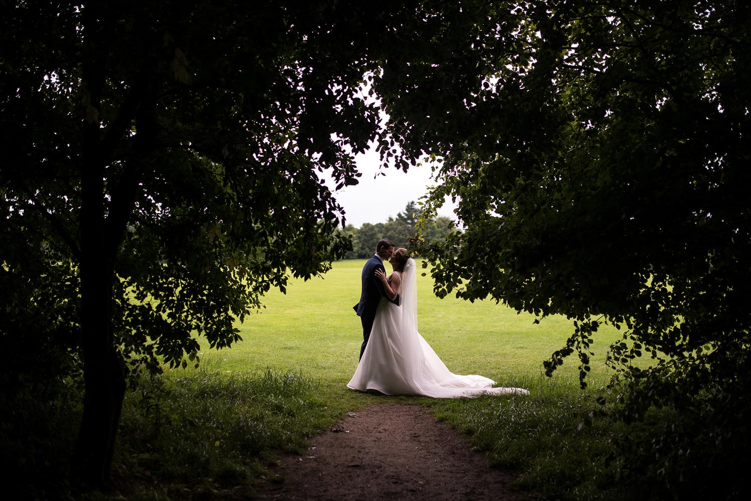 Couple kissing in the trees