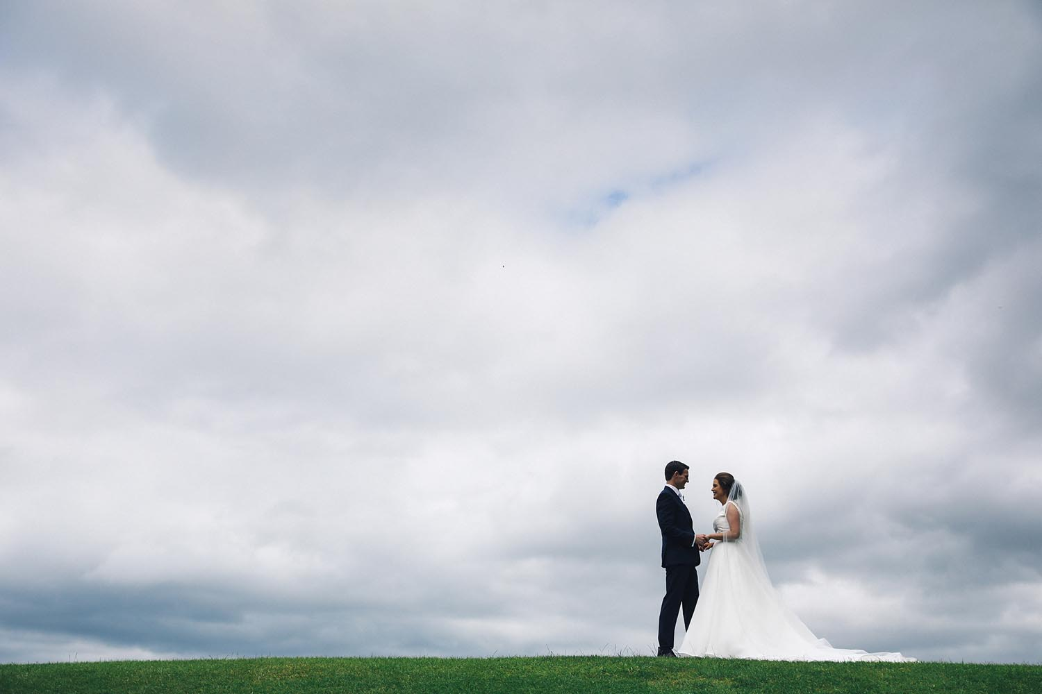 Shot of groom and bride on hill