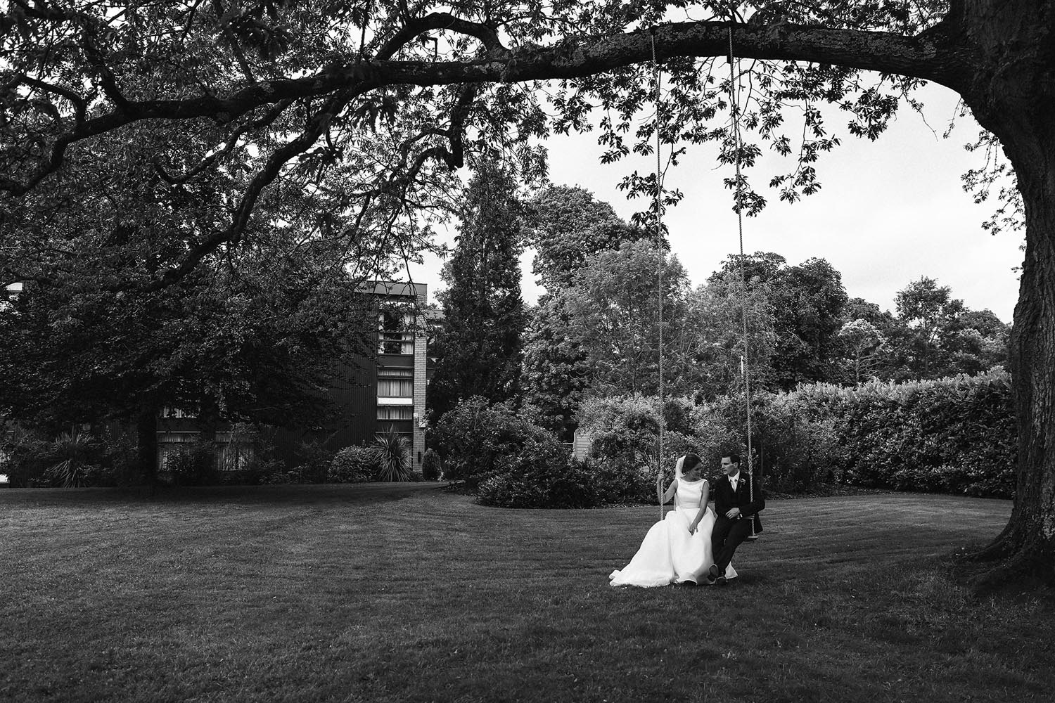 Newly married couple on a swing together at the Newpark Hotel Kilkenny