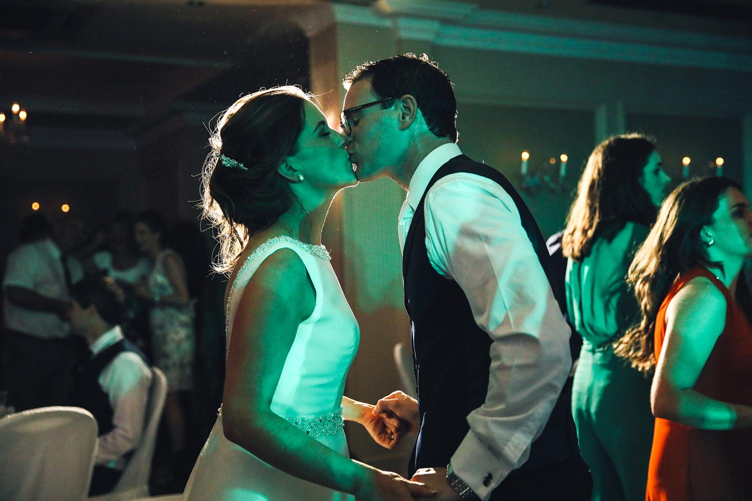 Bride and Groom kiss each other on the dancefloor