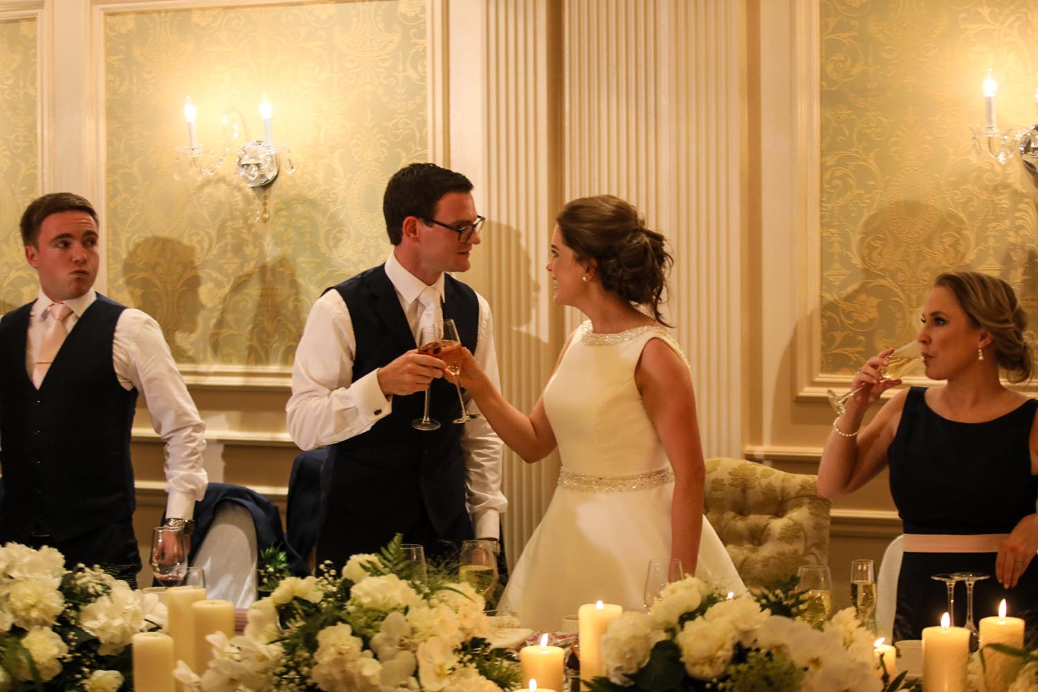 Couple toasting each other on their wedding day