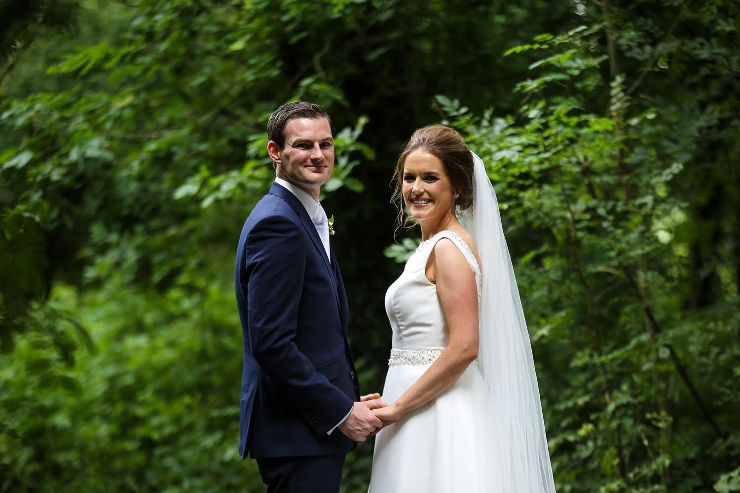 Portrait of married couple taken in the forest