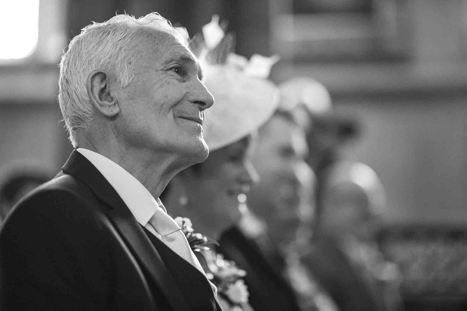 Father of the Bride looks on