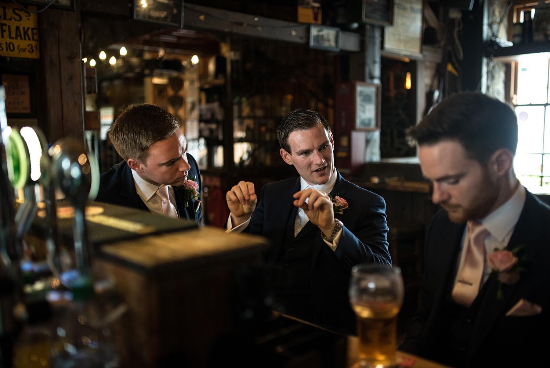 Groomsmen having a drink together