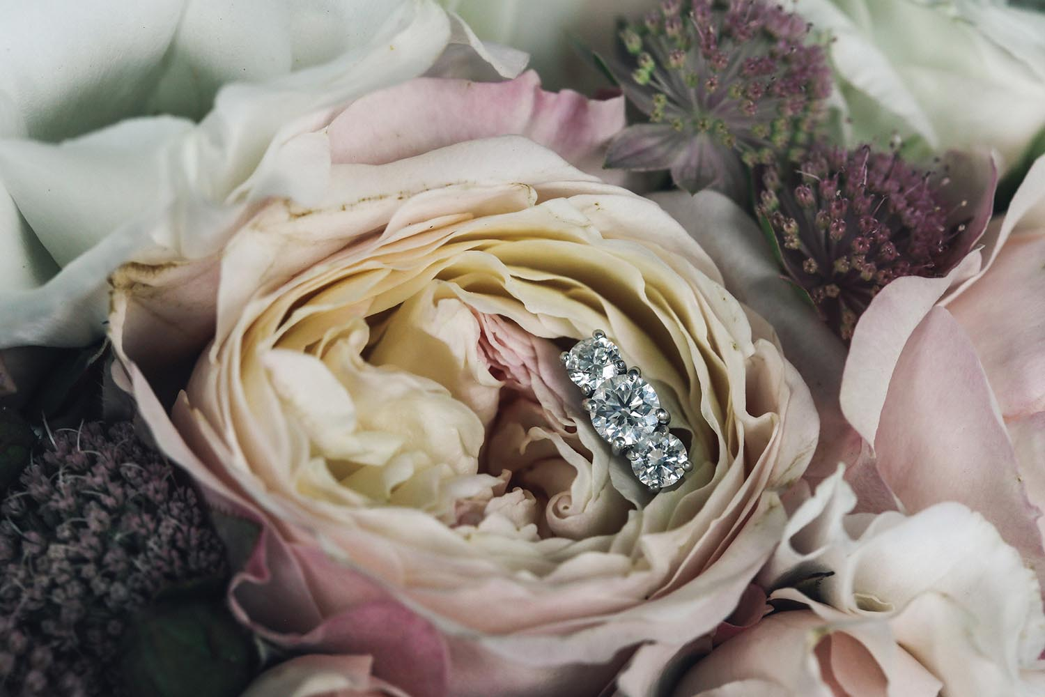Engagement ring in bridal bouquet
